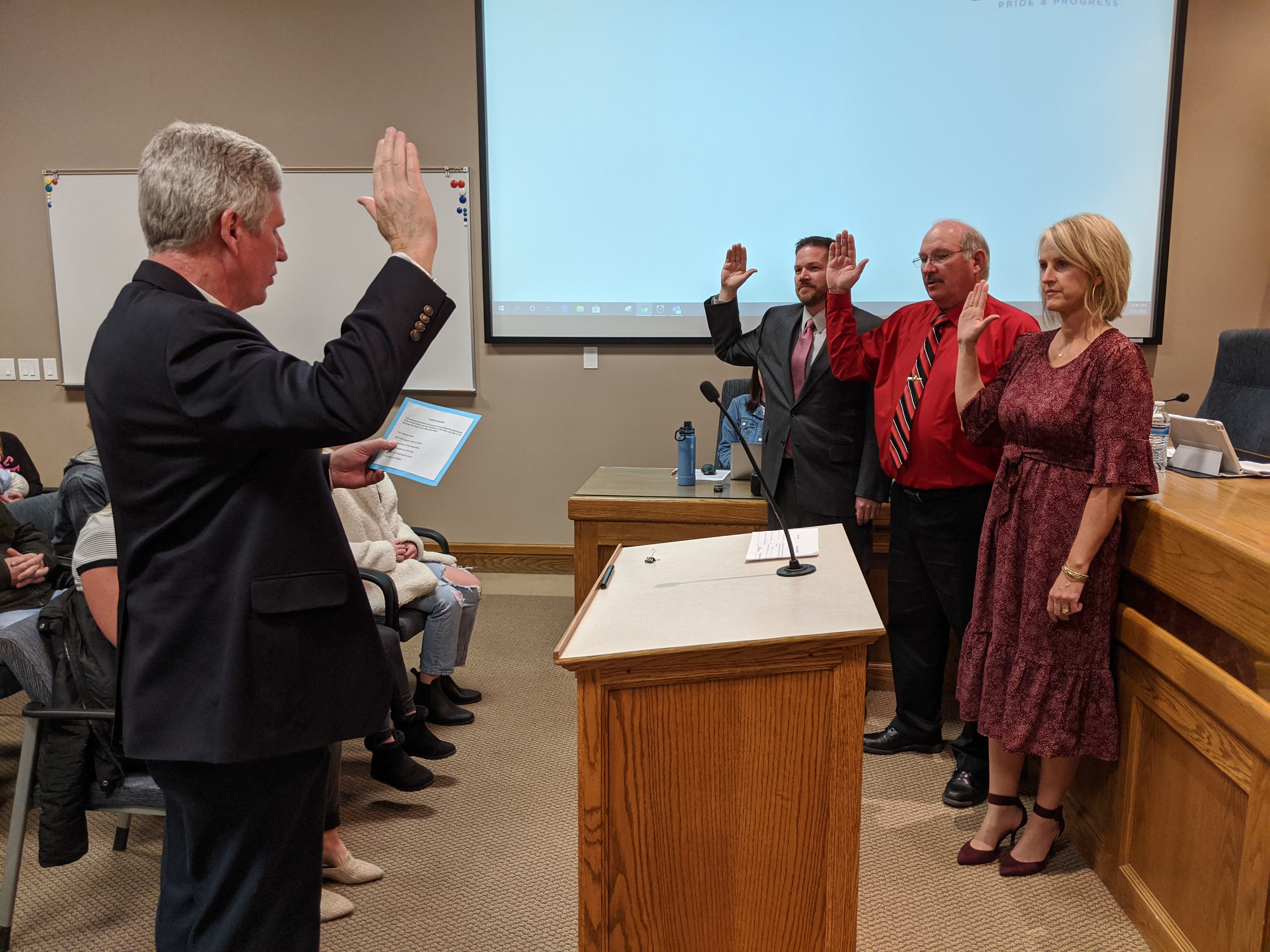 City Council Members Stacy Beck, Chard Argyle, and Brandon Gordon take the Oath of Office, as administered by City Recorder Kent Clark.
